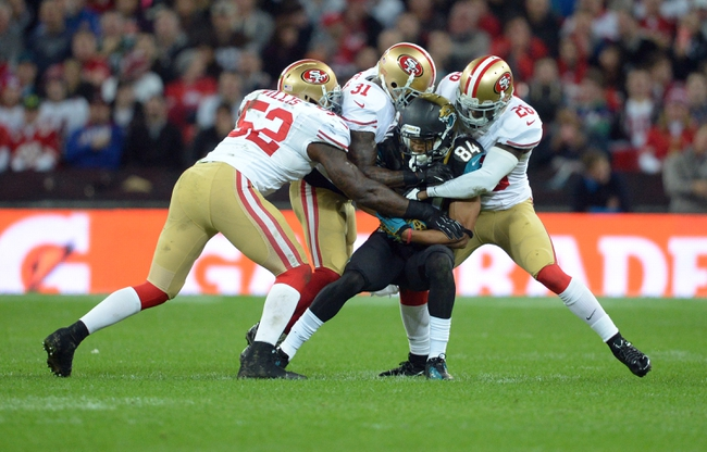 Oct 27, 2013; London, UNITED KINGDOM; Jacksonville Jaguars wide receiver Cecil Shorts (84) is tackled by San Francisco 49ers players Patrick Willis (52) , Donte Whitner (31) and Tramaine Brock (26) during an International Series game at Wembley Stadium. Mandatory Credit: Bob Martin-USA TODAY Sports
