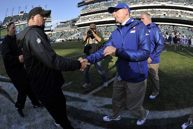 Oct 27, 2013; Philadelphia, PA, USA; New York Giants head coach Tom Coughlin (right) and Philadelphia Eagles head coach Chip Kelly (left) shake hands after the second half at Lincoln Financial Field. The Giants won the game 15-7. Mandatory Credit: Joe Camporeale-USA TODAY Sports