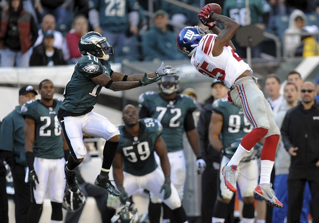 Oct 27, 2013; Philadelphia, PA, USA; New York Giants defensive back Will Hill (25) intercepts a pass intended for Philadelphia Eagles wide receiver DeSean Jackson (10) during the second half at Lincoln Financial Field. The Giants won the game 15-7. Mandatory Credit: Joe Camporeale-USA TODAY Sports