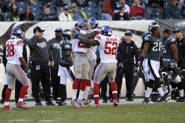 Oct 27, 2013; Philadelphia, PA, USA; The New York Giants celebrate an interception by defensive back Will Hill (25) against the Philadelphia Eagles during the second half at Lincoln Financial Field. The Giants won the game 15-7. Mandatory Credit: Joe Camporeale-USA TODAY Sports