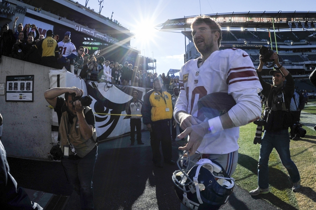 Oct 27, 2013; Philadelphia, PA, USA; New York Giants quarterback Eli Manning (10) leaves the field after the second half against the Philadelphia Eagles at Lincoln Financial Field. The Giants won the game 15-7. Mandatory Credit: Joe Camporeale-USA TODAY Sports
