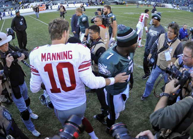Oct 27, 2013; Philadelphia, PA, USA; New York Giants quarterback Eli Manning (10) and Philadelphia Eagles quarterback Michael Vick (7) shake hands after the second half at Lincoln Financial Field. The Giants won the game 15-7. Mandatory Credit: Joe Camporeale-USA TODAY Sports