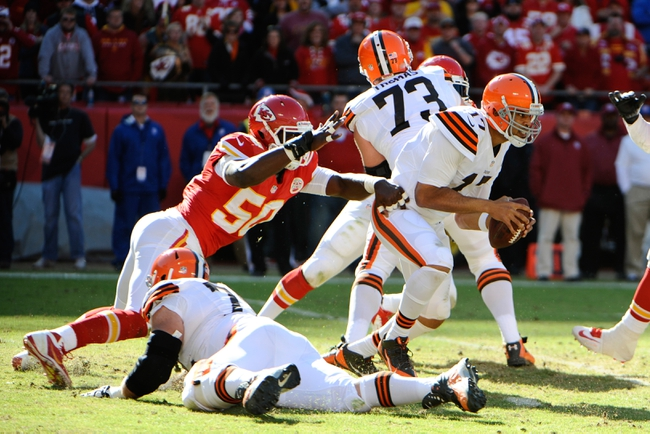 Oct 27, 2013; Kansas City, MO, USA; Cleveland Browns quarterback Jason Campbell (17) gets away from Kansas City Chiefs outside linebacker Justin Houston (50) in the second half at Arrowhead Stadium. The Chiefs won the game 23-17. Mandatory Credit: John Rieger-USA TODAY Sports