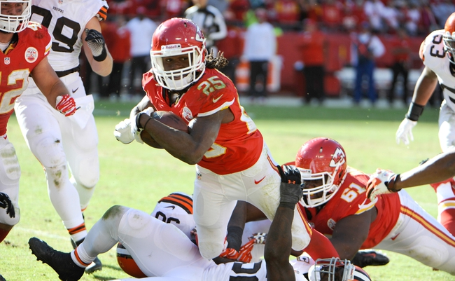Oct 27, 2013; Kansas City, MO, USA; Kansas City Chiefs running back Jamaal Charles (25) is tackled by Cleveland Browns nose tackle Phillip Taylor (98) in the second half at Arrowhead Stadium. The Chiefs won the game 23-17. Mandatory Credit: John Rieger-USA TODAY Sports