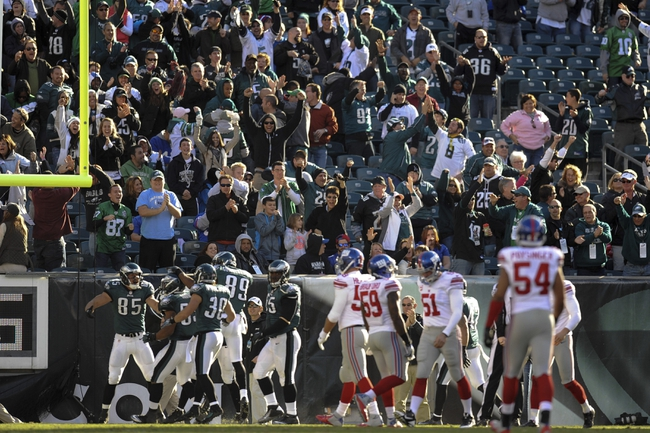 Oct 27, 2013; Philadelphia, PA, USA; Philadelphia Eagles linebacker Najee Goode (53) celebrates a special teams touchdown with teammates against the New York Giants during the second half at Lincoln Financial Field. The Giants won the game 15-7. Mandatory Credit: Joe Camporeale-USA TODAY Sports