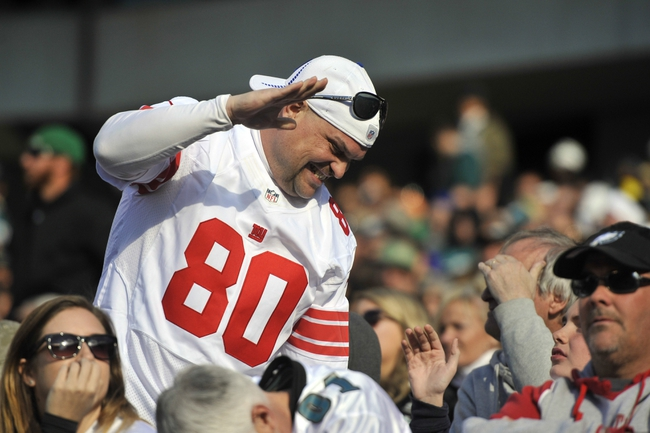 Oct 27, 2013; Philadelphia, PA, USA; A New York Giants fan celebrates against the Philadelphia Eagles during the second half at Lincoln Financial Field. The Giants won the game 15-7. Mandatory Credit: Joe Camporeale-USA TODAY Sports