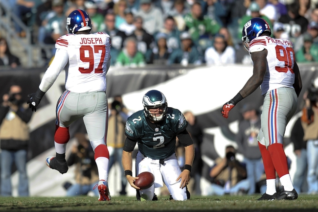 Oct 27, 2013; Philadelphia, PA, USA; New York Giants defensive tackle Linval Joseph (97) and defensive end Jason Pierre-Paul (90) react after sacking Philadelphia Eagles quarterback Matt Barkley (2) during the second half at Lincoln Financial Field. The Giants won the game 15-7. Mandatory Credit: Joe Camporeale-USA TODAY Sports