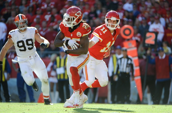 Oct 27, 2013; Kansas City, MO, USA; Kansas City Chiefs quarterback Alex Smith (11) hands off to running back Jamaal Charles (25) against the Cleveland Browns in the second half at Arrowhead Stadium. The Chiefs won the game 23-17. Mandatory Credit: John Rieger-USA TODAY Sports