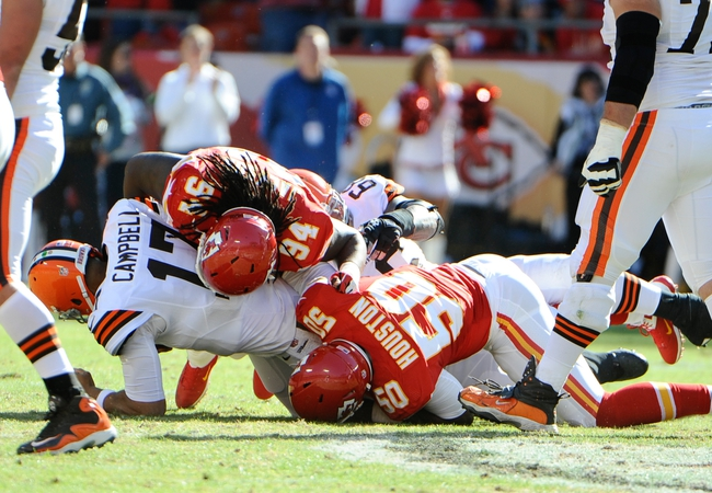 Oct 27, 2013; Kansas City, MO, USA; Cleveland Browns quarterback Jason Campbell (17) is sacked by Kansas City Chiefs defensive end Tyson Jackson (94) and outside linebacker Justin Houston (50) in the second half at Arrowhead Stadium. The Chiefs won the game 23-17. Mandatory Credit: John Rieger-USA TODAY Sports