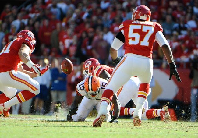 Oct 27, 2013; Kansas City, MO, USA; Cleveland Browns wide receiver Davone Bess (15) fumbles a punt against the Kansas City Chiefs in the second half at Arrowhead Stadium. The Chiefs won the game 23-17. Mandatory Credit: John Rieger-USA TODAY Sports