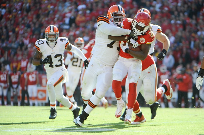 Oct 27, 2013; Kansas City, MO, USA; Kansas City Chiefs running back Jamaal Charles (25) is tackled by Cleveland Browns defensive end Ahtyba Rubin (71) in the second half at Arrowhead Stadium. The Chiefs won the game 23-17. Mandatory Credit: John Rieger-USA TODAY Sports