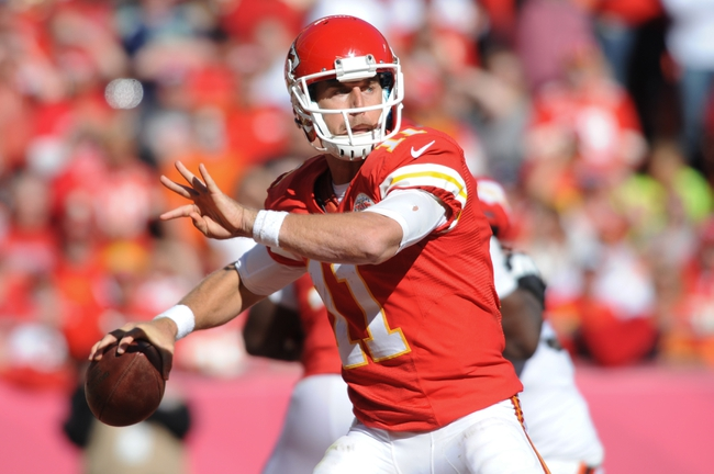 Oct 27, 2013; Kansas City, MO, USA; Kansas City Chiefs quarterback Alex Smith (11) throws a pass during the second half of the game against the Cleveland Browns at Arrowhead Stadium. The Chiefs won 23-17.  Mandatory Credit: Denny Medley-USA TODAY Sports
