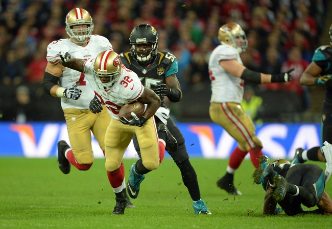 Oct 27, 2013; London, UNITED KINGDOM; San Francisco 49ers running back Kendall Hunter (32) runs past Jacksonville Jaguars outside linebacker Geno Hayes (55)  during an International Series game at Wembley Stadium. Mandatory Credit: Bob Martin-USA TODAY Sports