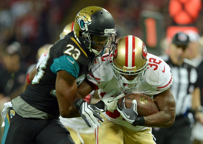 Oct 27, 2013; London, UNITED KINGDOM; San Francisco 49ers running back Kendall Hunter (32) is pushed out of bounds by Jacksonville Jaguars cornerback Alan Ball (23) during an International Series game at Wembley Stadium. Mandatory Credit: Bob Martin-USA TODAY Sports