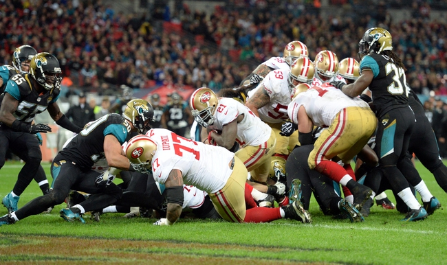 Oct 27, 2013; London, UNITED KINGDOM; San Francisco 49ers running back Frank Goren scores a touchdown against the Jacksonville Jaguars during an International Series game at Wembley Stadium. Mandatory Credit: Bob Martin-USA TODAY Sports