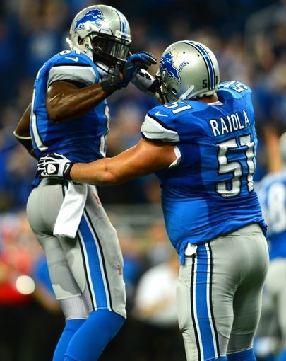 Oct 27, 2013; Detroit, MI, USA; Detroit Lions wide receiver Calvin Johnson (81) celebrates with Detroit Lions center Dominic Raiola (51) after a touchdown during the fourth quarter against the Dallas Cowboys at Ford Field. Mandatory Credit: Andrew Weber-USA TODAY Sports