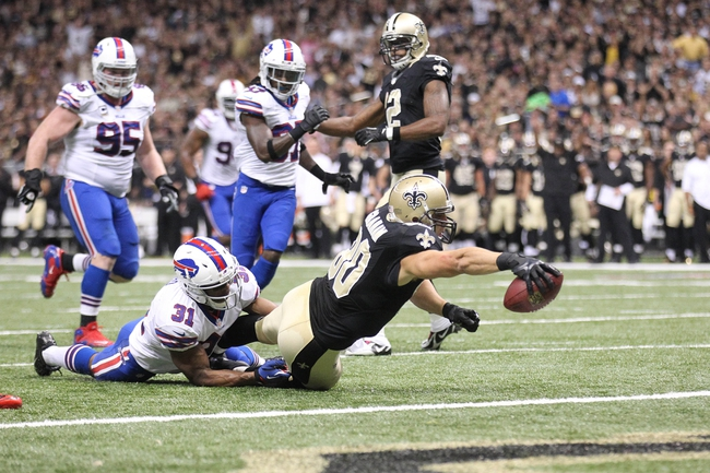 Oct 27, 2013; New Orleans, LA, USA; New Orleans Saints tight end Jimmy Graham (80) reaches for a touchdown in front of Buffalo Bills free safety Jairus Byrd (31) during the second half at Mercedes-Benz Superdome. New Orleans defeated Buffalo 35-17. Mandatory Credit: Crystal LoGiudice-USA TODAY Sports
