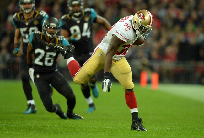 Oct 27, 2013; London, UNITED KINGDOM; San Francisco 49ers running back Kendall Hunter (32) runs with the ball against the Jacksonville Jaguars during an International Series game at Wembley Stadium. Mandatory Credit: Bob Martin-USA TODAY Sports