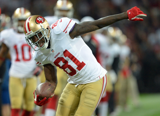 Oct 27, 2013; London, UNITED KINGDOM; San Francisco 49ers wide receiver Anquan Boldin (81) runs with the ball against the Jacksonville Jaguars during an International Series game at Wembley Stadium. Mandatory Credit: Bob Martin-USA TODAY Sports
