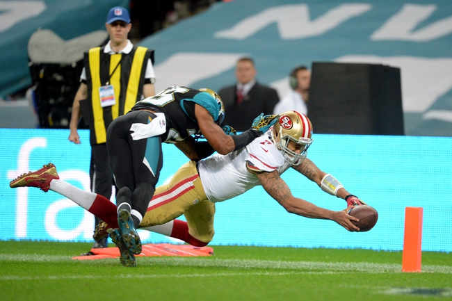 Oct 27, 2013; London, UNITED KINGDOM; San Francisco 49ers quarterback Colin Kaepernick (7) dives for the pylon against the Jacksonville Jaguars during an International Series game at Wembley Stadium. Mandatory Credit: Bob Martin-USA TODAY Sports