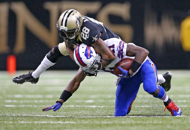 Oct 27, 2013; New Orleans, LA, USA; New Orleans Saints cornerback Keenan Lewis (28) tackles Buffalo Bills wide receiver T.J. Graham (11) during the second half at Mercedes-Benz Superdome. New Orleans defeated Buffalo 35-17. Mandatory Credit: Crystal LoGiudice-USA TODAY Sports