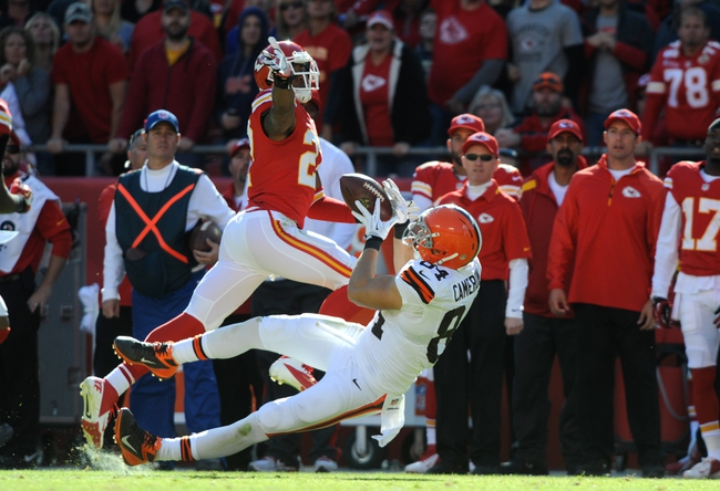 Oct 27, 2013; Kansas City, MO, USA; Cleveland Browns tight end Jordan Cameron (84) catches a pass against Kansas City Chiefs cornerback Sean Smith (27) in the second half at Arrowhead Stadium. The Chiefs won the game 23-17. Mandatory Credit: John Rieger-USA TODAY Sports