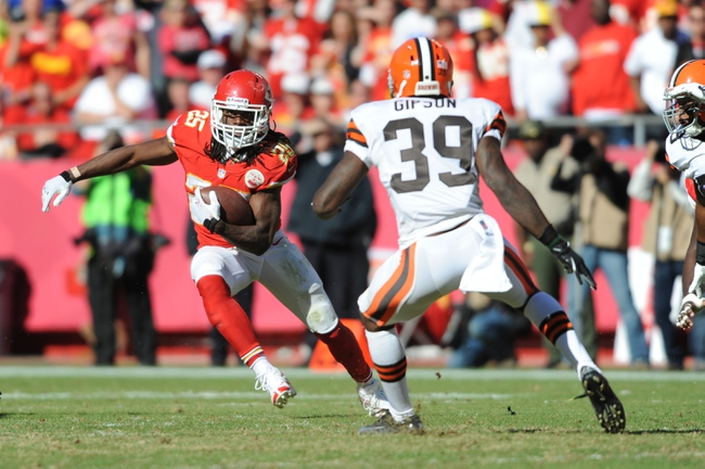 Oct 27, 2013; Kansas City, MO, USA; Kansas City Chiefs running back Jamaal Charles (25) runs the ball as Cleveland Browns free safety Tashaun Gipson (39) defends during the second half at Arrowhead Stadium. The Chiefs won 23-17.  Mandatory Credit: Denny Medley-USA TODAY Sports