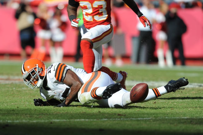 Oct 27, 2013; Kansas City, MO, USA; Cleveland Browns wide receiver Davone Bess (15) can't make the catch as Kansas City Chiefs free safety Kendrick Lewis (23) pressures during the second half at Arrowhead Stadium. The Chiefs won 23-17.  Mandatory Credit: Denny Medley-USA TODAY Sports