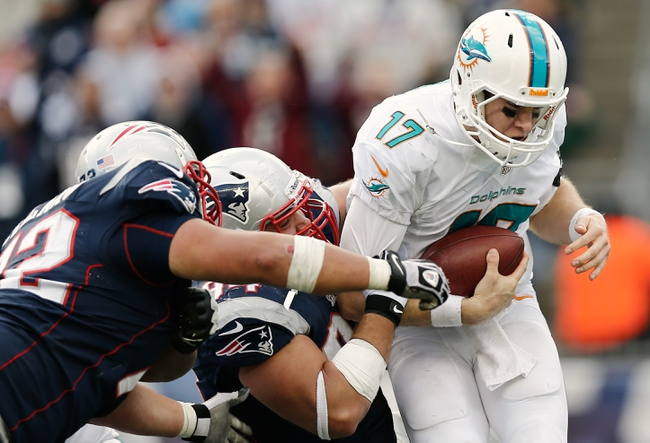 Oct 27, 2013; Foxborough, MA, USA; New England Patriots defensive tackle Chris Jones (94) sacks Miami Dolphins quarterback Ryan Tannehill (17) during the fourth quarter of their 27-17 win at Gillette Stadium. Mandatory Credit: Winslow Townson-USA TODAY Sports