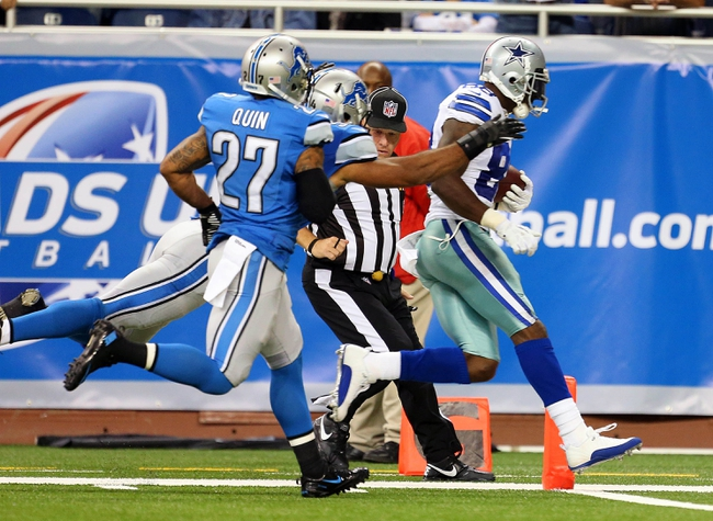 Oct 27, 2013; Detroit, MI, USA; Dallas Cowboys wide receiver Dez Bryant (88) scores a touchdown against Detroit Lions strong safety Glover Quin (27) during 2nd half of a game at Ford Field. Lions won 31-30. Mandatory Credit: Mike Carter-USA TODAY Sports