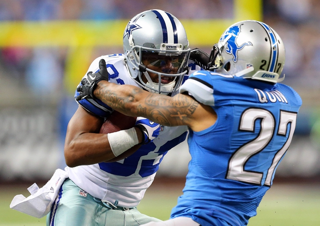 Oct 27, 2013; Detroit, MI, USA; Dallas Cowboys wide receiver Terrance Williams (83) breaks tackle of Detroit Lions strong safety Glover Quin (27) to score a touchdown during 2nd half of a game at Ford Field. Lions won 31-30. Mandatory Credit: Mike Carter-USA TODAY Sports