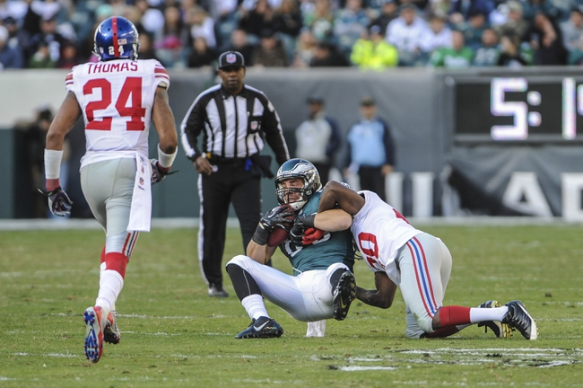 Oct 27, 2013; Philadelphia, PA, USA; Philadelphia Eagles tight end Zach Ertz (86) is tackled by New York Giants cornerback Prince Amukamara (20) during the fourth quarter  at Lincoln Financial Field. The New York Giants won the game 15-7. Mandatory Credit: John Geliebter-USA TODAY Sports