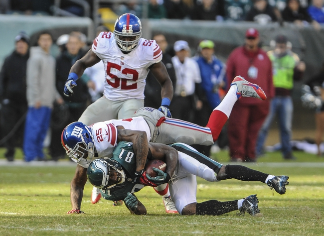 Oct 27, 2013; Philadelphia, PA, USA; Philadelphia Eagles wide receiver Jason Avant (81) is tackled by New York Giants defensive back Will Hill (25) during the fourth quarter at Lincoln Financial Field. The New York Giants won the game 15-7. Mandatory Credit: John Geliebter-USA TODAY Sports