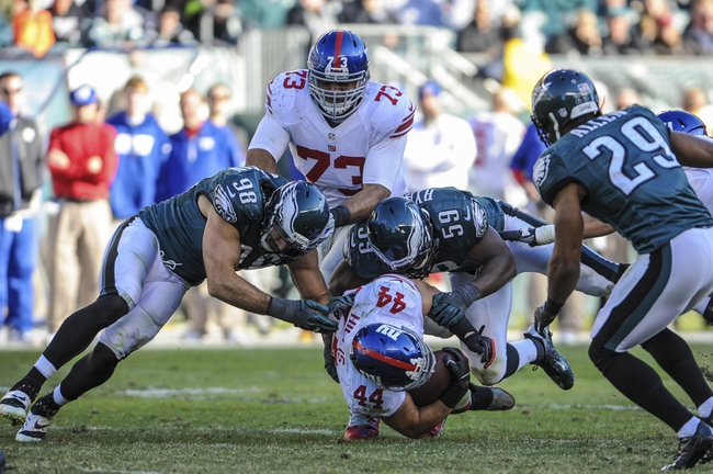 Oct 27, 2013; Philadelphia, PA, USA; New York Giants running back Peyton Hillis (44) is tackled by Philadelphia Eagles inside linebacker DeMeco Ryans (59) during the fourth quarter at Lincoln Financial Field. The New York Giants won the game 15-7. Mandatory Credit: John Geliebter-USA TODAY Sports