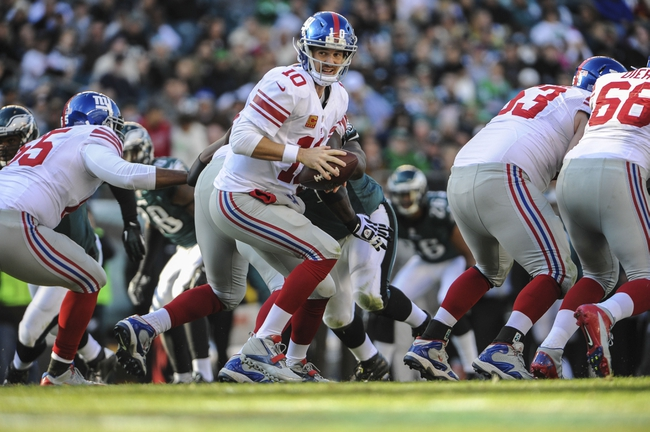 Oct 27, 2013; Philadelphia, PA, USA; New York Giants quarterback Eli Manning (10) looks to hand the ball off during the fourth quarter of the game against the Philadelphia Eagles at Lincoln Financial Field. The New York Giants won the game 15-7. Mandatory Credit: John Geliebter-USA TODAY Sports