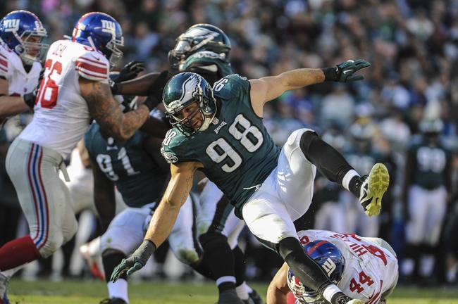 Oct 27, 2013; Philadelphia, PA, USA; Philadelphia Eagles outside linebacker Connor Barwin (98) is blocked by New York Giants running back Peyton Hillis (44) during the fourth quarter at Lincoln Financial Field. The New York Giants won the game 15-7. Mandatory Credit: John Geliebter-USA TODAY Sports