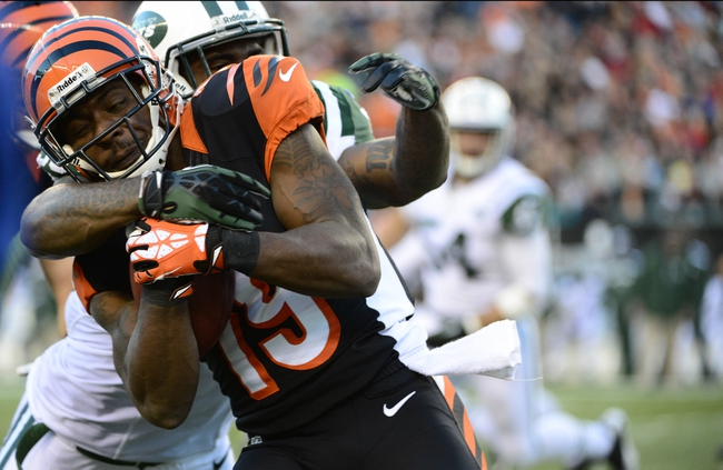 Oct 27, 2013; Cincinnati, OH, USA; Cincinnati Bengals wide receiver Brandon Tate (19) is tackled by New York Jets running back Alex Green (25) during the second half of the game at Paul Brown Stadium. Mandatory Credit: Marc Lebryk-USA TODAY Sports