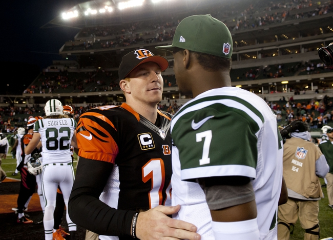 Oct 27, 2013; Cincinnati, OH, USA; Cincinnati Bengals quarterback Andy Dalton (14) stops to talk to New York Jets quarterback Geno Smith (7) after the game at Paul Brown Stadium. Mandatory Credit: Marc Lebryk-USA TODAY Sports