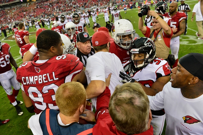 Oct 27, 2013; Phoenix, AZ, USA; Atlanta Falcons running back Jacquizz Rodgers (32), Arizona Cardinals defensive end Calais Campbell (93) and teammates engage in a post game scuffle at University of Phoenix Stadium. Mandatory Credit: Matt Kartozian-USA TODAY Sports