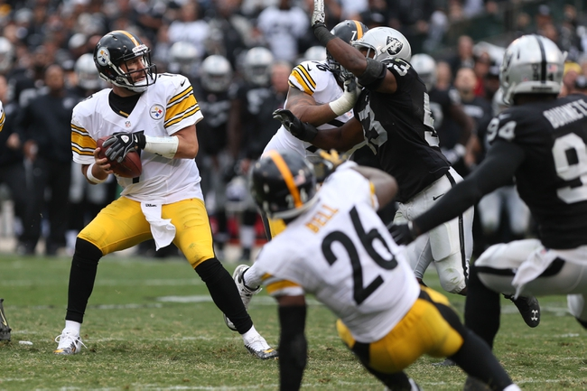 Oct 27, 2013; Oakland, CA, USA; Pittsburgh Steelers quarterback Ben Roethlisberger (7) looks for an open receiver against the Oakland Raiders during the fourth quarter at O.co Coliseum. The Oakland Raiders defeated the Pittsburgh Steelers 21-18. Mandatory Credit: Kelley L Cox-USA TODAY Sports