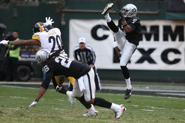 Oct 27, 2013; Oakland, CA, USA; Oakland Raiders punter Marquette King (7) punts the ball against the Pittsburgh Steelers during the fourth quarter at O.co Coliseum. The Oakland Raiders defeated the Pittsburgh Steelers 21-18. Mandatory Credit: Kelley L Cox-USA TODAY Sports