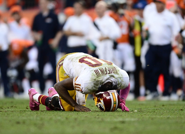Oct 27, 2013; Denver, CO, USA; Washington Redskins quarterback Robert Griffin III (10) lays injured after a sack by Denver Broncos defensive tackle Terrance Knighton (94) (not pictured) in the fourth quarter at Sports Authority Field at Mile High. Mandatory Credit: Ron Chenoy-USA TODAY Sports