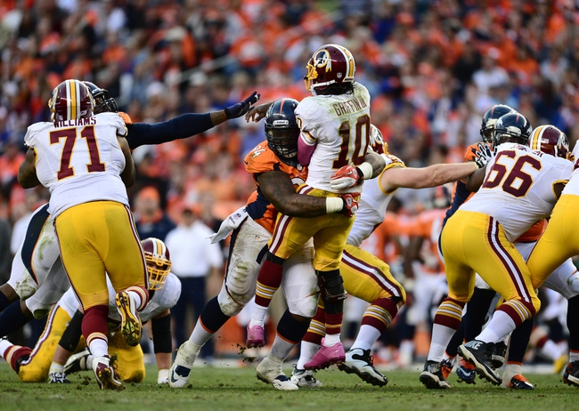Oct 27, 2013; Denver, CO, USA; Denver Broncos defensive tackle Terrance Knighton (94) sacks Washington Redskins quarterback Robert Griffin III (10) in the fourth quarter at Sports Authority Field at Mile High. Mandatory Credit: Ron Chenoy-USA TODAY Sports