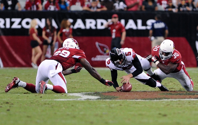 Oct 27, 2013; Phoenix, AZ, USA; Atlanta Falcons punter Matt Bosher (5) recovers an on side kick against the Arizona Cardinals running back Alfonso Smith (29) and running back Stepfan Taylor (30) in the second half at University of Phoenix Stadium. The Cardinals defeated the Falcons 27-13. Mandatory Credit: Jennifer Stewart-USA TODAY Sports