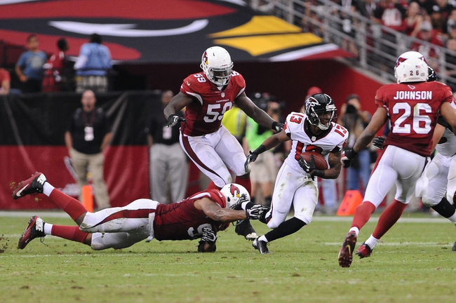 Oct 27, 2013; Phoenix, AZ, USA; Atlanta Falcons wide receiver Darius Johnson (13) runs the ball against the Arizona Cardinals defensive end Malliciah Goodman (93) and outside linebacker Joplo Bartu (59) in the second half at University of Phoenix Stadium. The Cardinals defeated the Falcons 27-13. Mandatory Credit: Jennifer Stewart-USA TODAY Sports