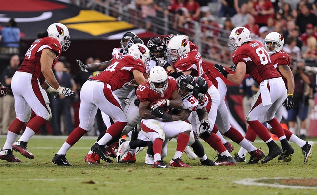 Oct 27, 2013; Phoenix, AZ, USA; Arizona Cardinals running back Stepfan Taylor (30) runs the ball against the Atlanta Falcons middle linebacker Akeem Dent (52) in the second half at University of Phoenix Stadium. The Cardinals defeated the Falcons 27-13. Mandatory Credit: Jennifer Stewart-USA TODAY Sports