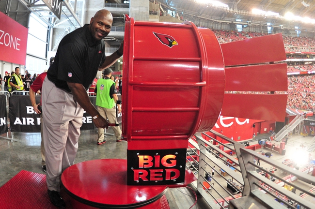 Oct 27, 2013; Phoenix, AZ, USA; Former Arizona Cardinals player Bertrand Berry poses with the Big Red Siren prior to the game against the Atlanta Falcons at University of Phoenix Stadium. Mandatory Credit: Matt Kartozian-USA TODAY Sports