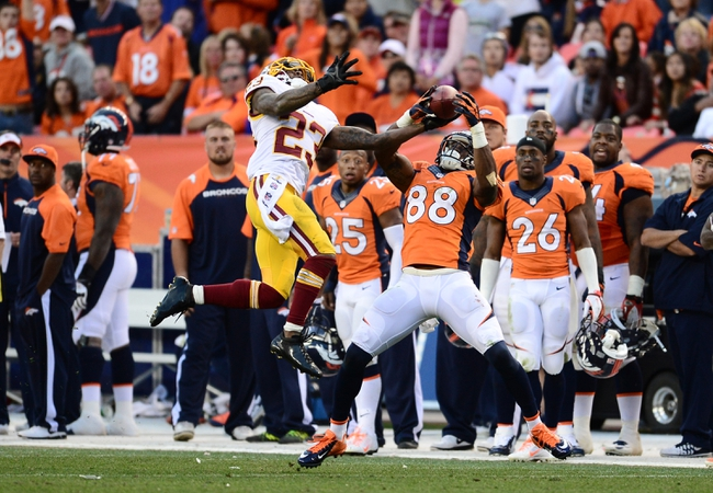 Oct 27, 2013; Denver, CO, USA; Washington Redskins cornerback DeAngelo Hall (23) intercepts a pass intended for Denver Broncos wide receiver Demaryius Thomas (88) in the fourth quarter at Sports Authority Field at Mile High. Mandatory Credit: Ron Chenoy-USA TODAY Sports