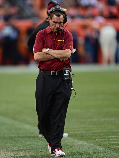 Oct 27, 2013; Denver, CO, USA; Washington Redskins head coach Mike Shanahan walks his sidelines in the fourth quarter against the Denver Broncos at Sports Authority Field at Mile High. Mandatory Credit: Ron Chenoy-USA TODAY Sports