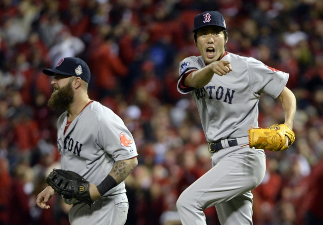 Oct 27, 2013; St. Louis, MO, USA; Boston Red Sox relief pitcher Koji Uehara (right) celebrates with first baseman Mike Napoli (left) after game four of the MLB baseball World Series against the St. Louis Cardinals at Busch Stadium. Mandatory Credit: H.Darr Beiser-USA TODAY Sports